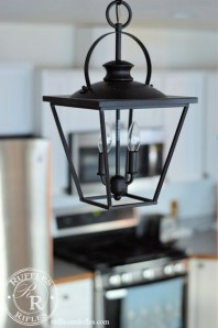 Farmhouse lantern pentdant hangs over the kitchen island.